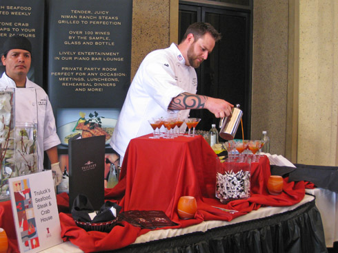 Truluck's executive chef Nate Boothe pours his tomato gazpacho mini-martinis with blueberry balsamic reduction and crab finger