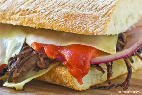 Post image for Red Wine-Braised Flank Steak with Roasted Peppers, Onions & Gruyere Panini