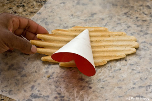 Lay your cone mold on the hot cookie - gotta work quickly!