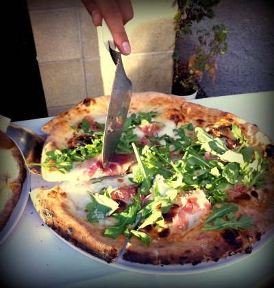 Prosciutto and arugula pizza from Isola Pizza Bar